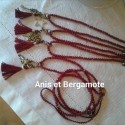 Sautoir perles cristal rouge, pampille métal, pompon