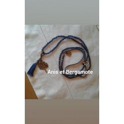 Sautoir perles cristal montana,  pampille métal, pompon