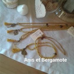 Sautoir perles cristal safran,  pampille métal, pompon