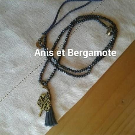 Sautoir perles cristal montana AB, pampille métal, pompon