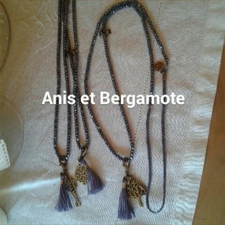 Sautoir perles cristal violet AB, pampille métal, pompon