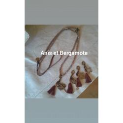 Sautoir perles cristal marron glacé,  pampille métal, pompon