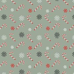 tissu patchwork de Noël, sur fond vert avec des sucres d'orges
