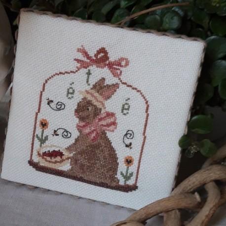grille de point de croix avec un petit lapin