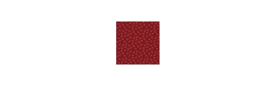 tissu patchwork dans différents tons de rouge de différents créateurs