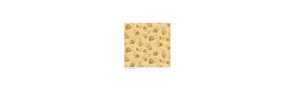 tissu pour le patchwork dans des tons de orange et jaune